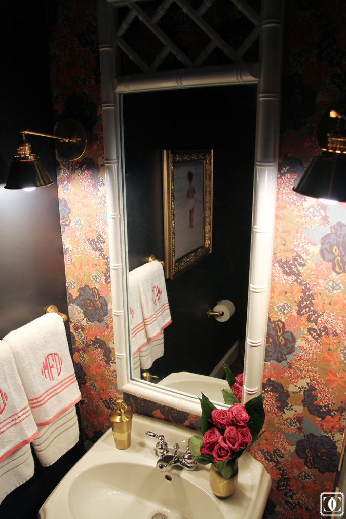 Gold frames, powder room, bamboo mirror, brass lights, wallpaper powder bath
