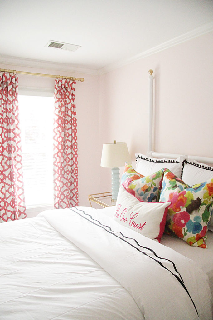 guest room bedding, colorful drapes, colorful pillows