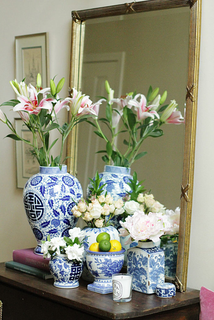 blue and white ginger jars, gold mirror