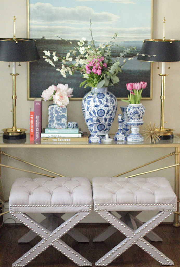 x-benches, ginger jars, coffee table, gold lamps