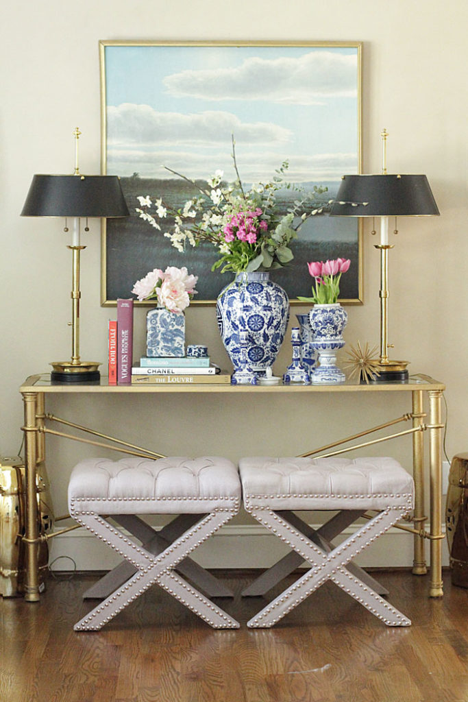 x-benches, ginger jars, gold lamps, coffee table