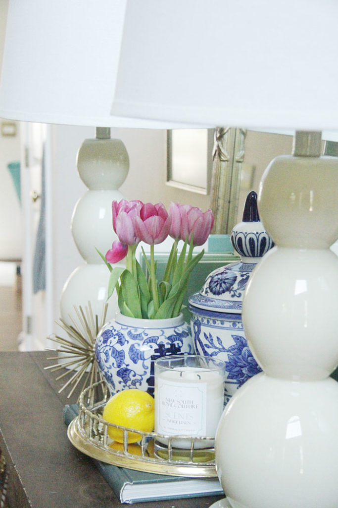brass bamboo tray, blue and white ginger jars, white lamps