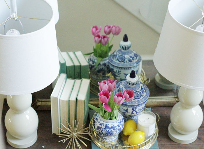 entry way, white lamps, brass bamboo tray, gold urchin, blue and white ginger jars