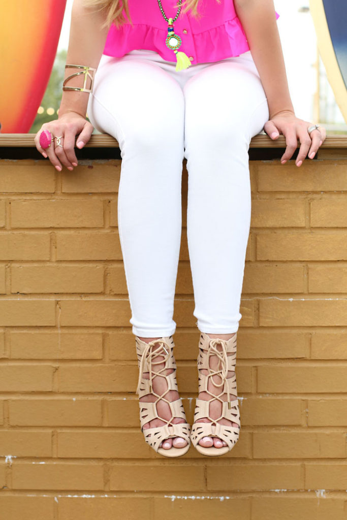 pink ruffle top, white denim, rebecca minkoff, tassel necklace, lace up heels