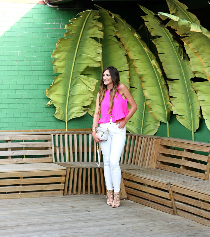 pink ruffle top, white denim, rebecca minkoff, tassel necklace