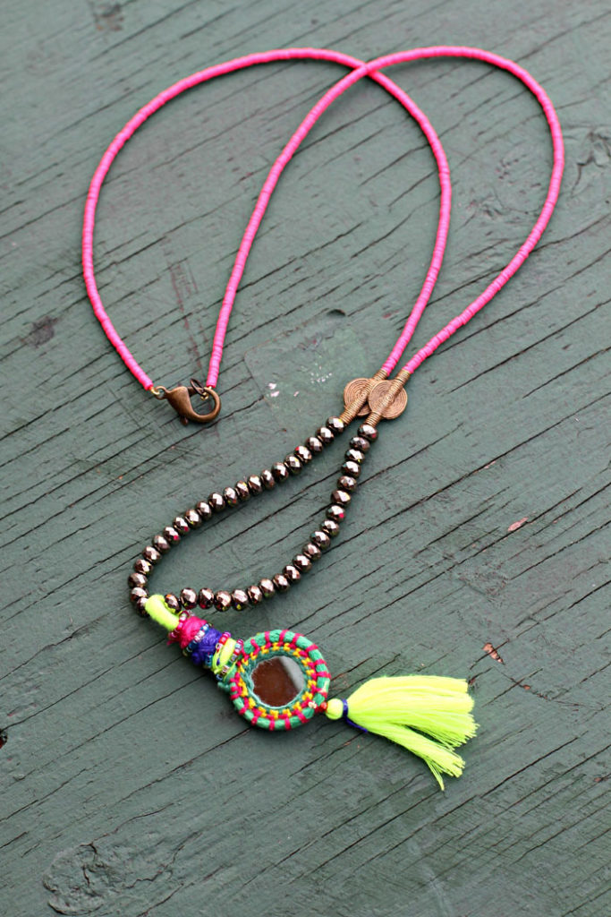 pink ruffle top, white denim, rebecca minkoff, tassel necklace