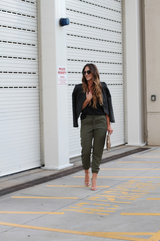 Jogger pants, leather jacket, prada sunglasses, leopard clutch