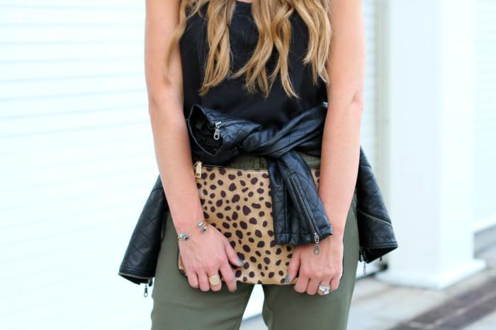 Jogger pants, leather jacket, prada sunglasses, leopard clutch