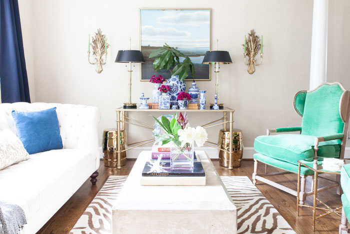 Front Room, Family Room, Modern Chic, Zebra Rug, Tufted Sofa, brass, concrete table