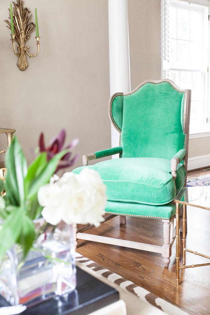 Front Room, Family Room, Modern Chic, Zebra Rug, Tufted Sofa, brass, concrete table, green velvet chair