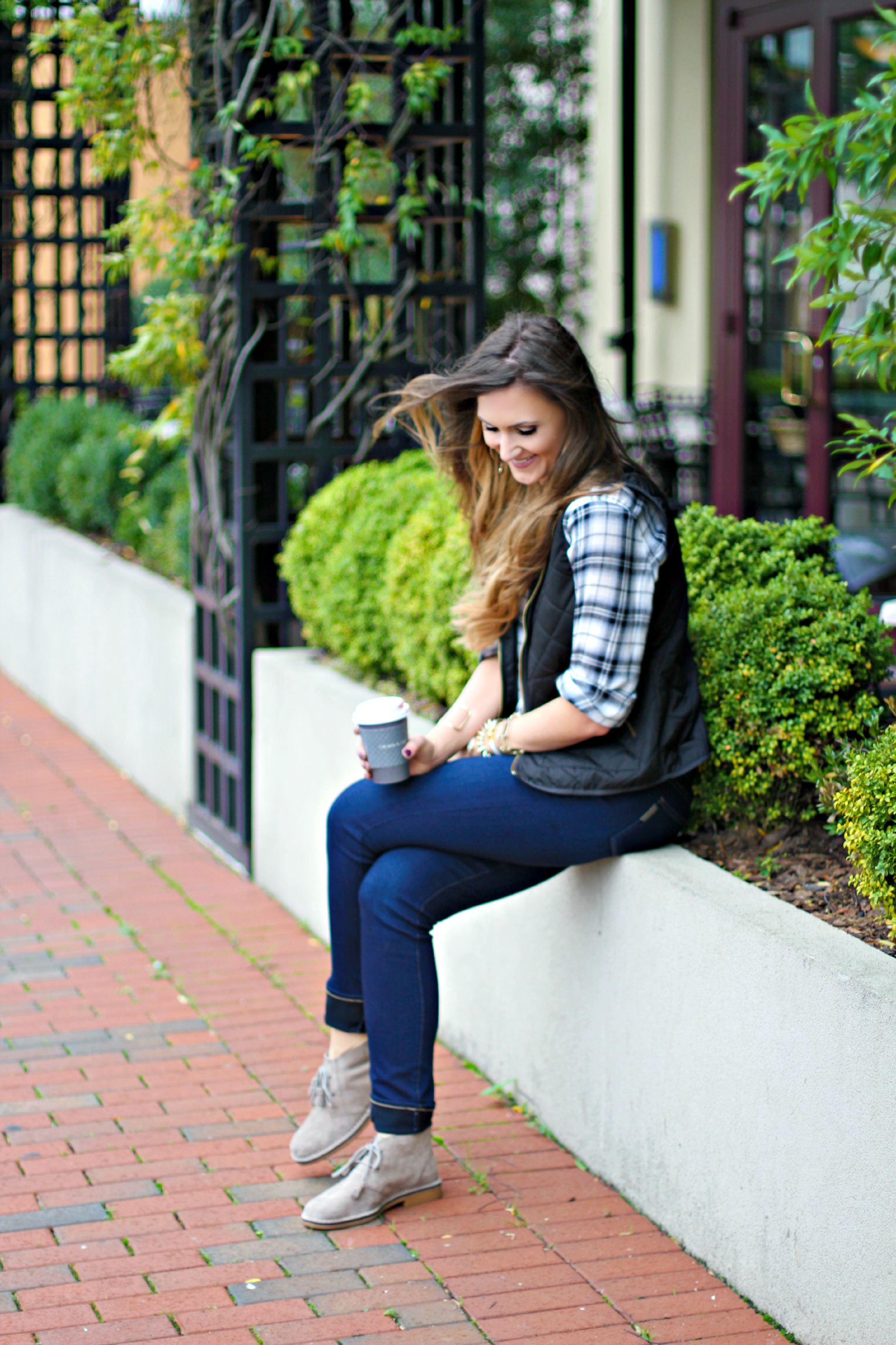 plaid shirt, puffer vest, chukka boots, coffee, skinny jeans