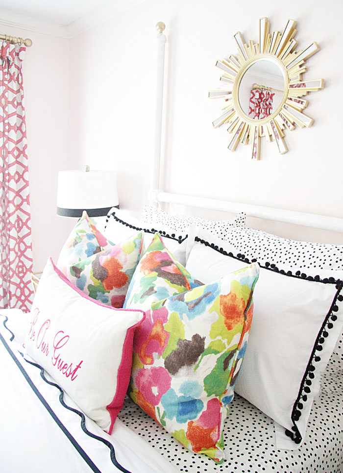 guest room, colorful, floral pillow, sunburst mirror