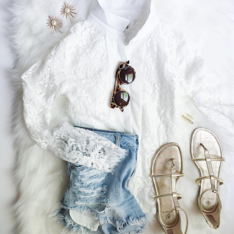 Pair a dainty lace top with distressed denim shorts and top with luxe gold accessories for a chic summer look.