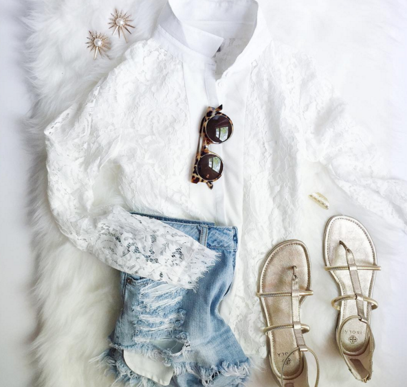 Pairing a dainty lace top with distressed denim shorts sis a fun play on texture for Spring.