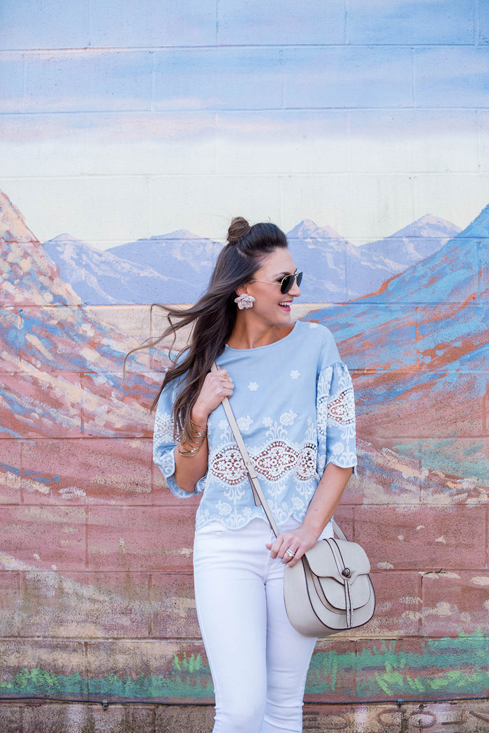 Try pairing this embroidered chambray top with white denim and pink heels for a fun Spring outfit.