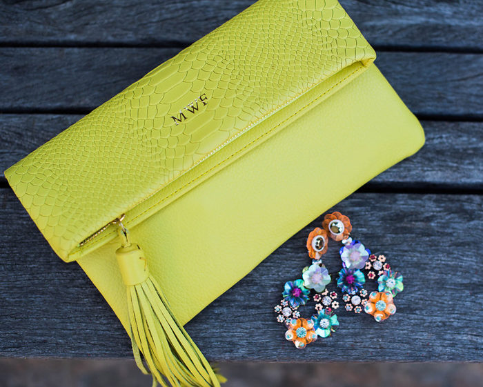 Add a pop of neon with this convertible clutch and statement earrings!