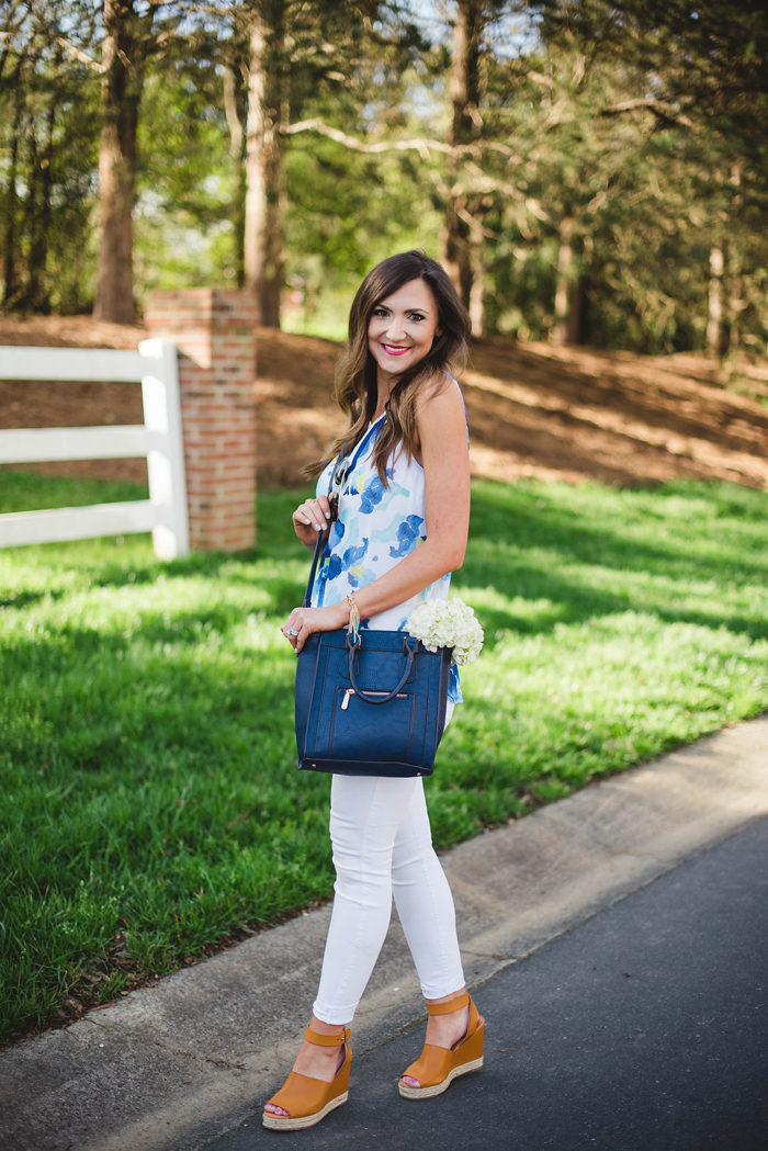 This fun look with Charming Charlie is easy to dress up and down.This fun floral top, navy cross body and trendy wedges from Charming Charlie make for a great Spring outfit.