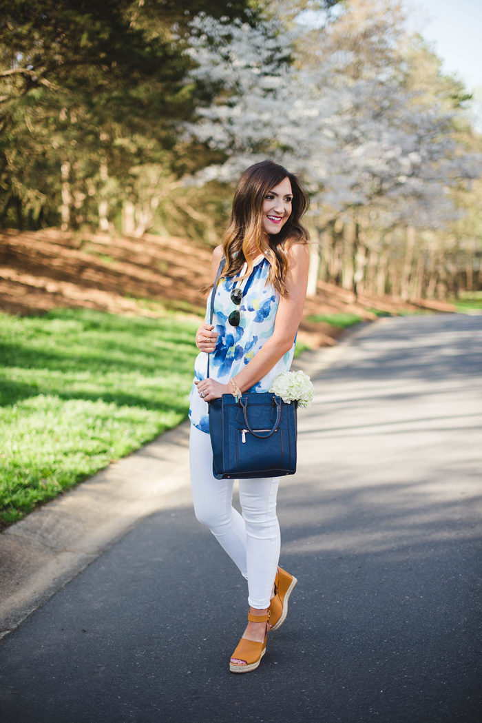 This fun floral top, navy cross body and trendy wedges from Charming Charlie make for a great Spring outfit.