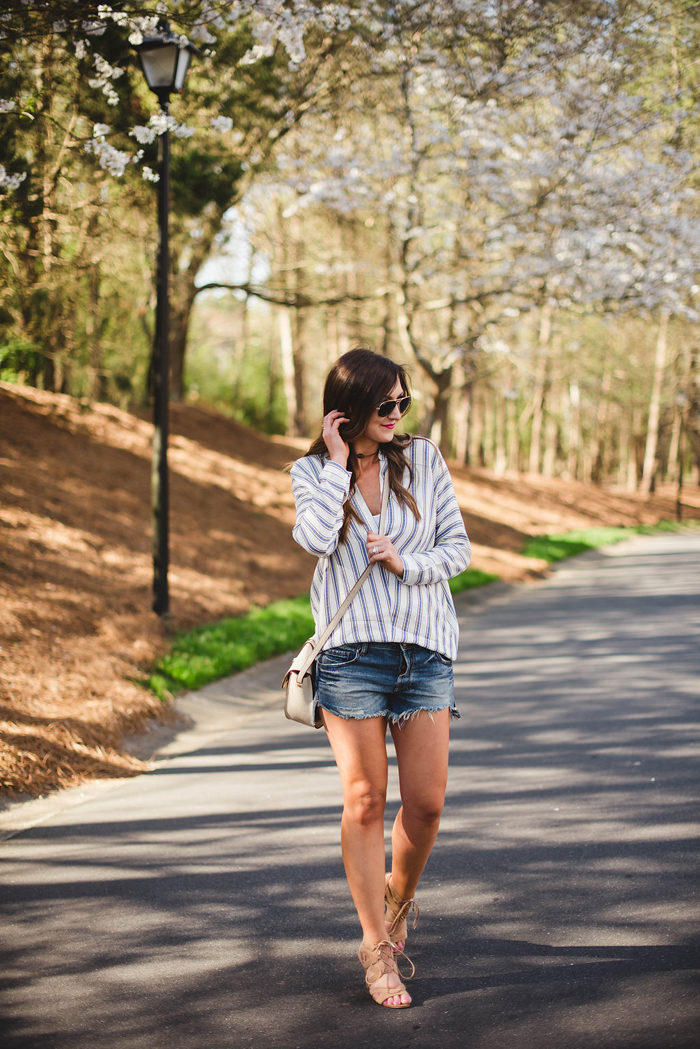 A laid back, casual outfit with a light linen tunic and distressed denim shorts!
