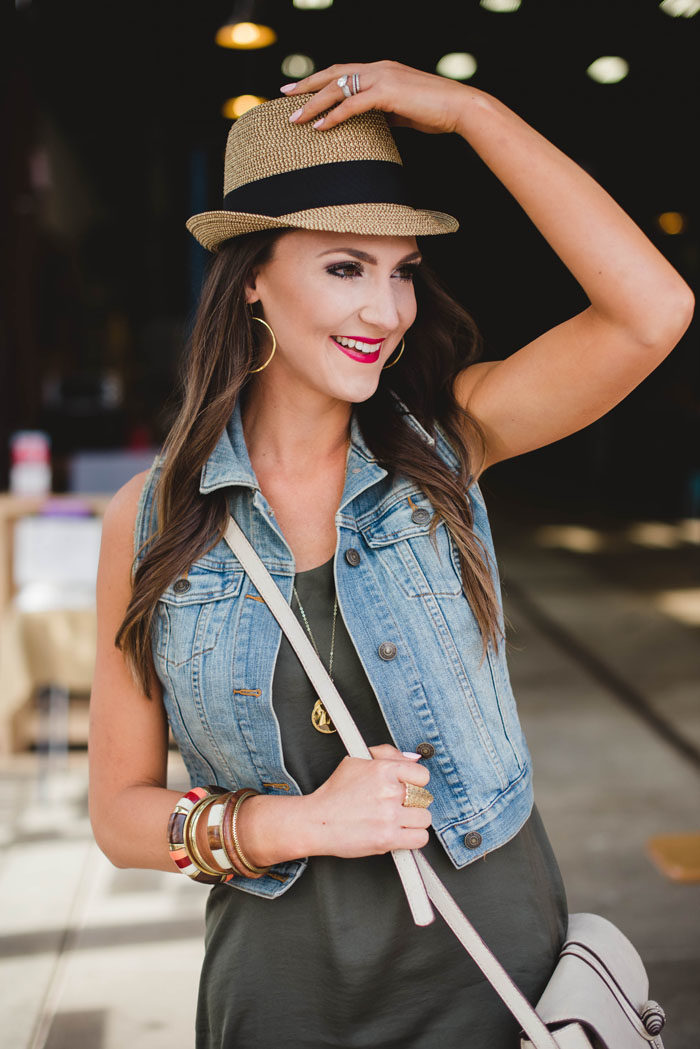 Olive green dress with denim vest and straw fedora