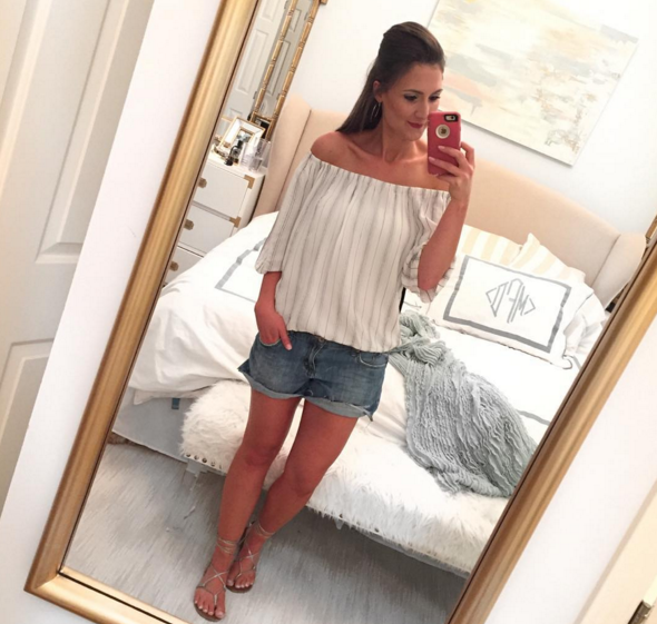 Off the shoulder top and distressed denim shorts