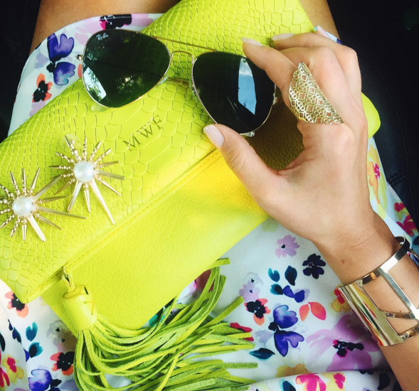 Neon clutch and statement earrings