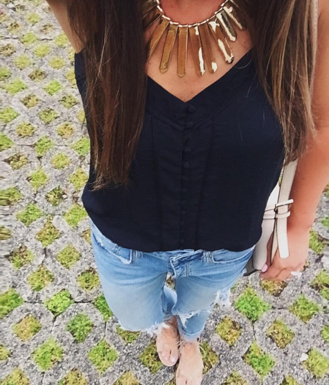 statement necklace and distressed denim