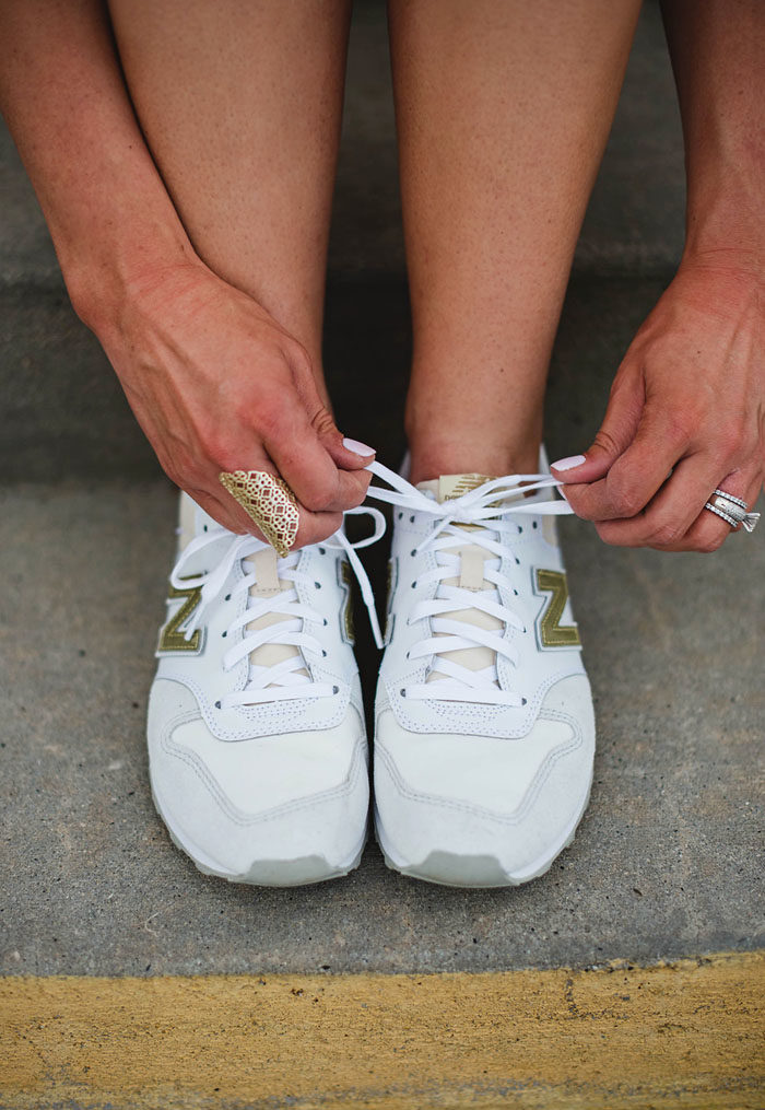 White and gold New Balance sneakers for women