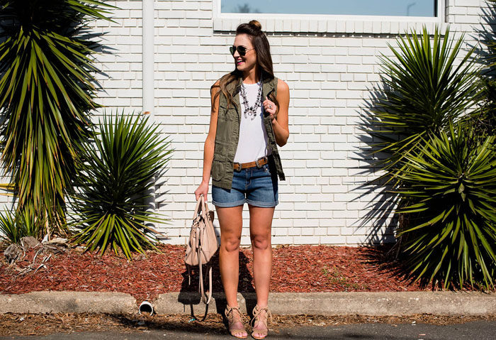 Pair denim shorts with a military vest and add southwestern accessories for a fun Summer look.