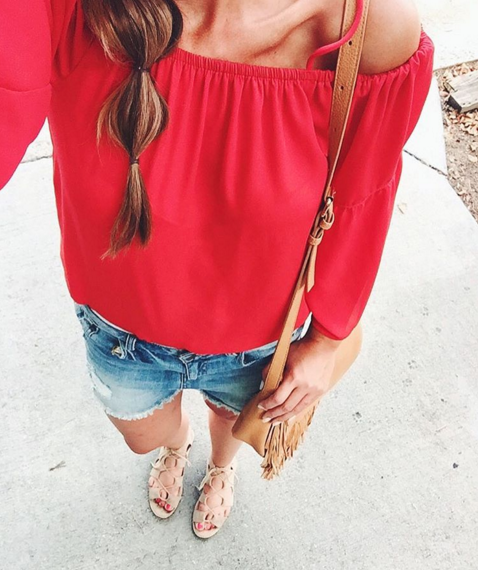 Red off cold shoulder top with distressed denim