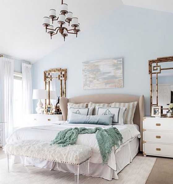 Calming master bedroom retreat mixing gold, light blue and white for a classic chic feel.