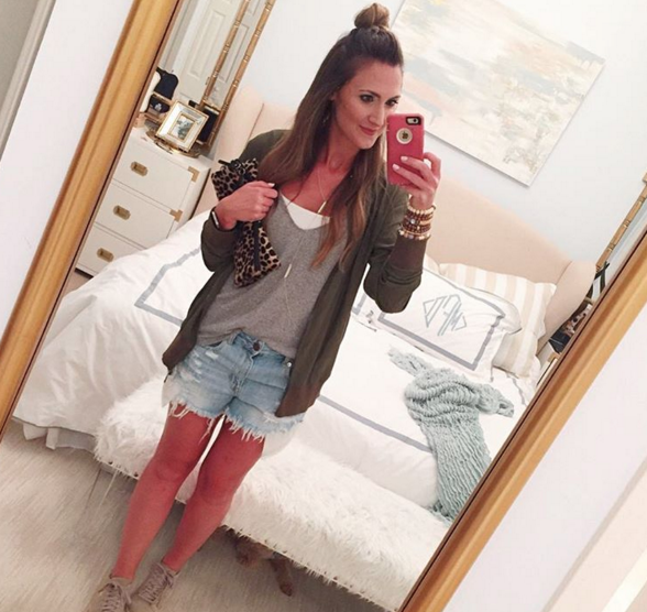 Wear an olive green bomber jacket with your favorite denim shorts to make the transition to Fall
