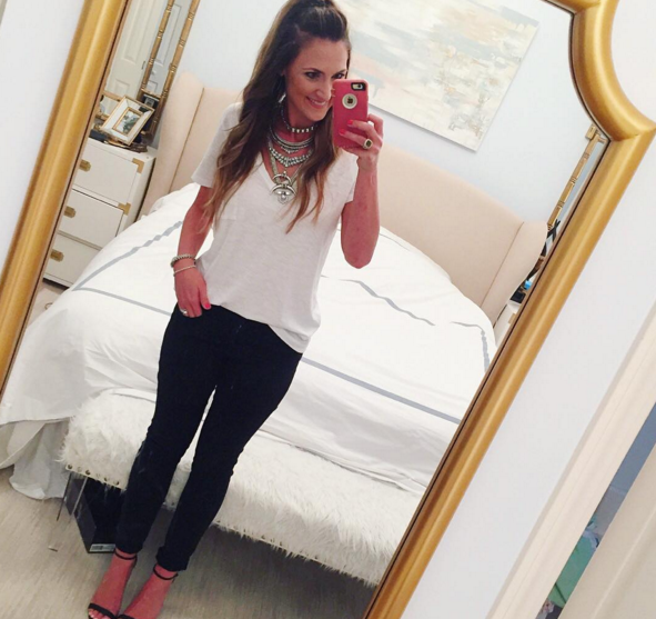 Blogger Mallory Fitzsimmons of Style Your Senses wears a casual white tee with black skinny jeans and a statement necklace for a casual chic outfit