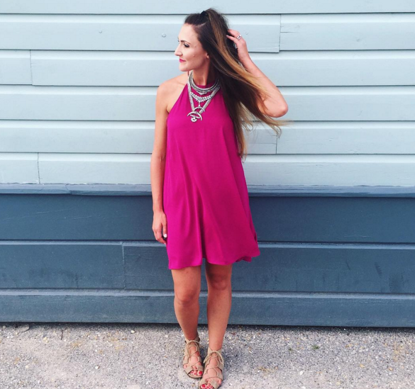 Blogger Mallory Fitzsimmons of Style Your Senses wears a pink trapeze dress and statement necklace in Seaside, Florida