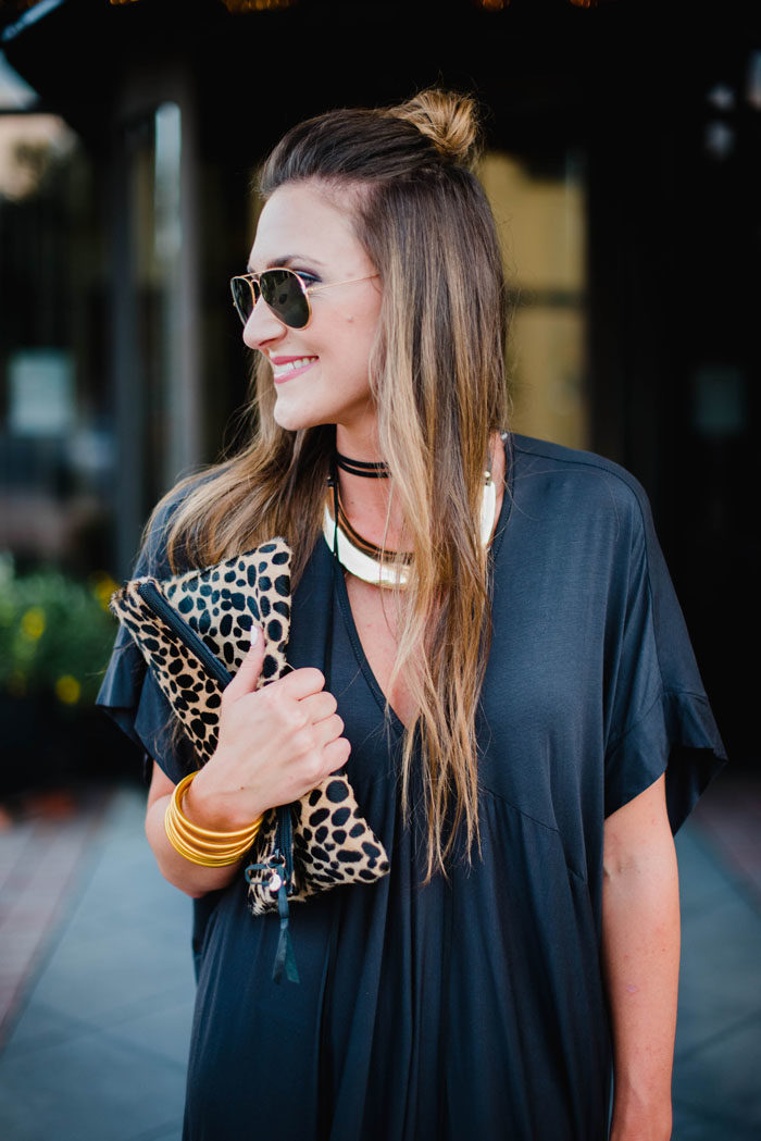 Blogger Mallory Fitzsimmons of Style Your Senses is wearing a chic black shift dress and a trend right black choker for a great Fall transition look.