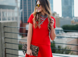 Red Donna Morgan swing dress paired with booties for a chic Fall transition outfit.