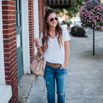 Blogger Mallory Fitzsimmons of Style Your Senses wears a Madewell white t-shirt and distressed boyfriend denim with loafers for a casual chic Fall look.