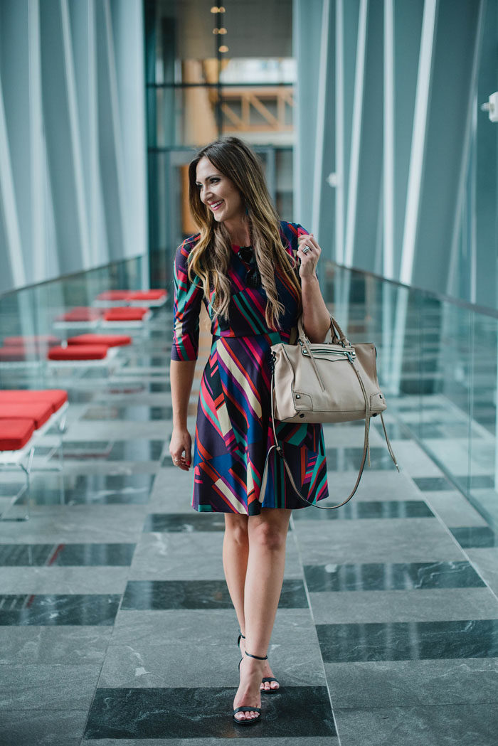 Blogger Mallory Fitzsimmons of Style Your Senses wears a Donna Morgan geometric print dress for Fall office wear.