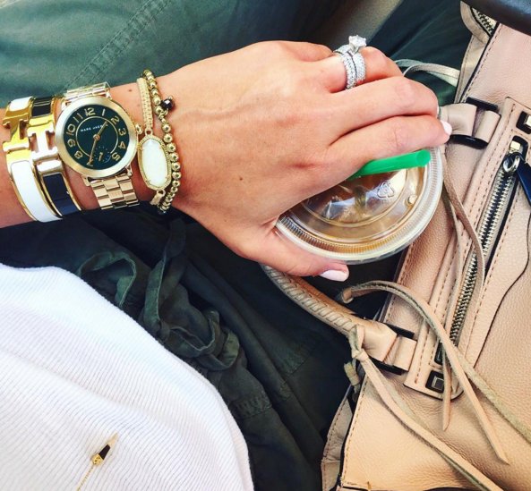Marc Jacobs gold watch as part of a Fall arm stack