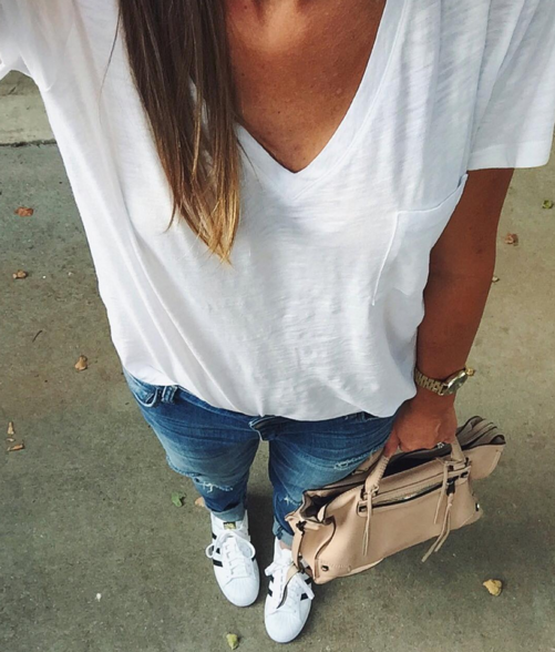 Mallory's Momiform wearing a great white tshirt, distressed boyfriend jeans and adidas superstar shoes.
