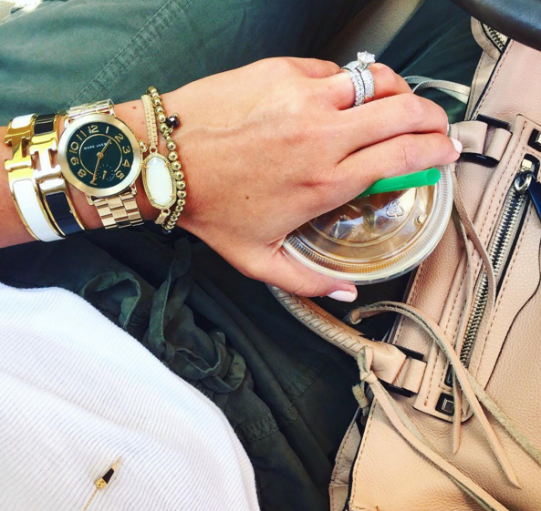 This gold Marc Jacobs watch with a hunter green face is the perfect arm candy for Fall