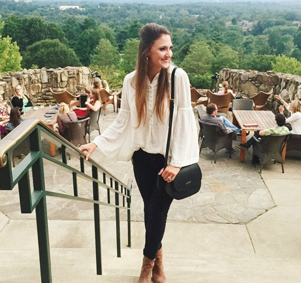Blogger Mallory Fitzsimmons of Style Your Senses wears this bell sleeve Free people top and black skinny jeans for a weekend in Asheville
