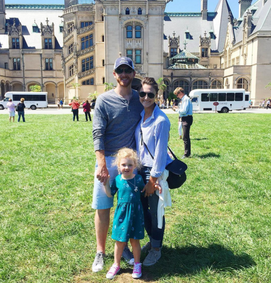 A family photo in from of the Biltmore Mansion