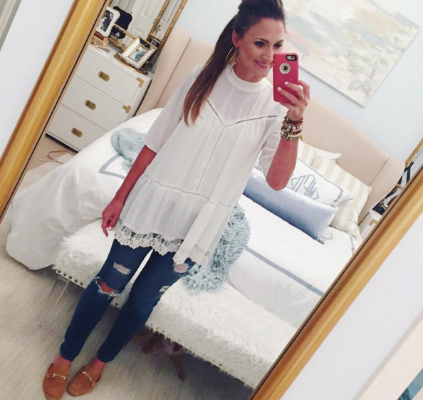 Blogger Mallory Fitzsimmons of Style Your Senses wears a darling lace tunic with boyfriend jeans and mules