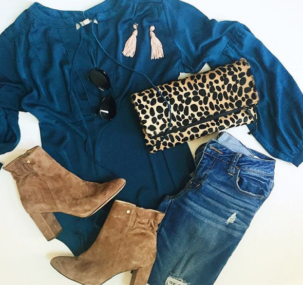 Flatlay outfit with gorgeous teal blue silk top, boyfriend denim, leopard clutch and cute booties