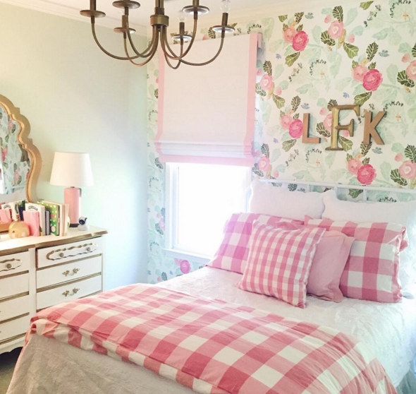 Gorgeous and feminine little girls room with floral wallpaper and gingham bedding