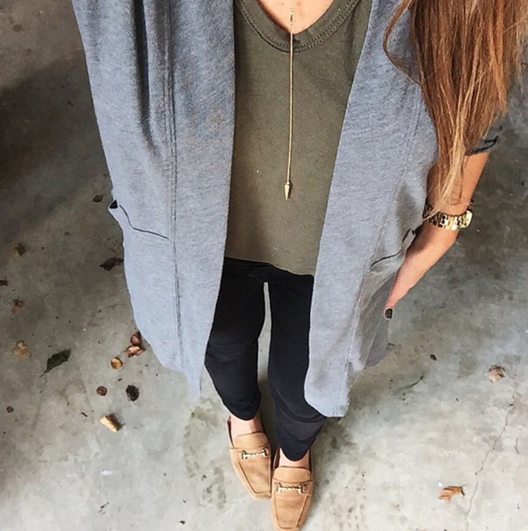 A casual and cozy Fall outfit with a lightweight cardigan, black denim and an olive green t-shirt.