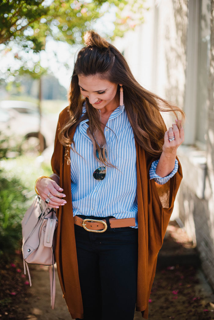 Blogger Mallory Fiztsimmons of Style Your Senses wears a casual striped button up top with black skinny denim and a rust cardigan for a casual Fall look.
