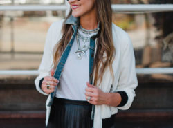 Blogger Mallory Fitzsimmons of Style Your Senses wears a J. Crew pleated leather skirt and bomber jacket as a transitional Fall outfit.