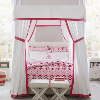 Gorgeous fabric canopy bed in girls room